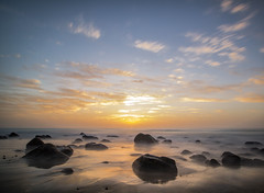Here comes the sun (grbush) Tags: sun sunrise sea seascape ocean sky clouds rocks longexposure atlantic sand beach canaryislands fuerteventura lumixg olympusm918mm
