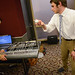Student demonstrates mechanical music maker project.