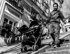 Street - Clever dad (François Escriva) Tags: street streetphotography paris france candid people man olympus omd black white bw noir blanc nb pushchair stroller buggy dad daddy father stairs montmartre buildings sky blue trees photo rue