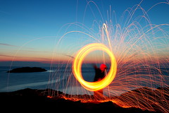 Fire, woman and sea... (Πύρ, γυνή και θάλασσα...) (Michael Kalognomos) Tags: fire woman sea longexposure ef24105mmf4l canoneos70d kythnos greece woolwire sunset sparkles spinning rocks landscape waterfront milkywaves sky calmness serenity