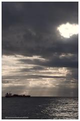 Rays of light in a storm (Rhannel Alaba) Tags: light sea storm nikon rays d90 pido at alaba lifeatsea rhannel