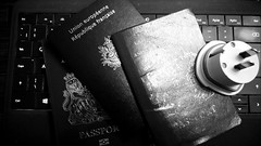 Camberley 24 October 2014 001 (paul_appleyard) Tags: passports adapter nokia lumia 925 black white flickrfriday readbetweenthelines plug us twopin french british passport surreyheath