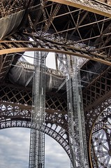 Elaborate underside of the Eiffel Tower.
