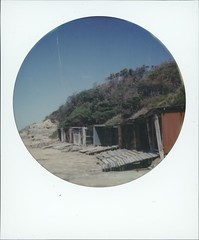 BOAT SHEAD (Eva Flaskas) Tags: impossible project color shade round frame abandoned boat shead bulli nsw decay rust old historic beach sand surf sea