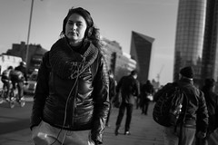 The Evening Commute (Cliff.j) Tags: london blackfriars commute evening sunshine shadow candid eye contact leather jacket headphones girl shawl city commuters street bridge sony a7 carl zeiss 55mm sonnar listening music rush hour