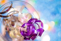 Happy 10 Years Macro Mondays! 🎉 (Kate H2011) Tags: katehighley macromondays macro ef100mmf28macrousm closeup happy10years indoor handheld glass ribbon bokeh depthoffield silver purple blue festive hmm hbmm