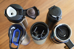 cracked water bottle / mug lids (yourbestdigs) Tags: water bottle travel mug coffee thermos hot drink drinks beverage bottles mugs office leak stainless steel insulated warm liquid food lid lids wood desk table dining tea hydration morning breakfast drinking exercising