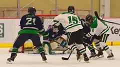 Peering through the screen... (R.A. Killmer) Tags: hockey goalie ice skate sru mercyhurst puck shot green white acha