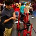 Student demonstrates Rube Goldberg machine.