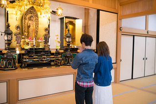 Young couple praying in temple