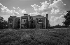 Forever Incomplete (GnarlyRelics) Tags: light sky urban blackandwhite bw white house black tree abandoned overgrown monochrome beautiful beauty up field grass stone clouds lost mono daylight dallas nikon day texas angle time fort decay tx urbandecay wide over property wideangle tokina forgotten urbanexploration land unfinished daytime worth lonely mansion behind left exploration f28 abandonment fortworth grown boarded incomplete dfs urbex leftbehind sanger d7100 1116mm