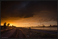 02-10-2014, IJmuiden, Burning sky (Koen langs de baan) Tags: sunset sky sun cars clouds dark steel tata ships tracks burning northseacanal ijmuiden noordzeekanaal vislijn ijmuiderlijn ijmuiderspoorlijn