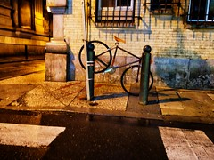 Bicycle parking - impression (henk.sijgers (on and off)) Tags: city light urban brown black brick water metal bronze night reflections gold cityscape availablelight bicycles pa nik philly asphalt topaz m43 gm1 15mmf17 leicadgsummilux15f17