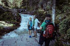 Photographing (Daveography.ca) Tags: park usa mountains waterfall nationalpark montana tourist tourists falls waterfalls backpack jenn hiker glaciernationalpark backpacker photographing stmaryfalls