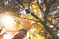 Life Controlling (goonkvilaivanh) Tags: sun fall apple smart glare hand bokeh young falling artsy smartphone flare catch reach generation phones iphone 5s rely