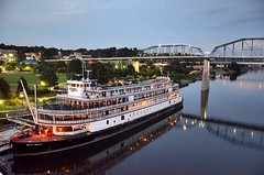 Delta Queen - Twilight (Roland 22) Tags: red white reflection green lights evening twilight flickr dusk tennessee carousel riverboat steamboat walnutstreetbridge tennesseeriver chattanoogatn coolidgepark deltaqueen palebluesky faintwhitegrayclouds