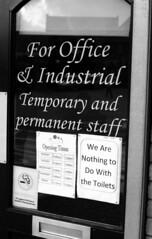 No responsibility (Trojan_Llama) Tags: bw signs film window shop rollei 35mm pentax front retro 55mm responsibility spotmatic toilets 400s wisbech sp500 r09