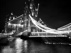 DSCF5086a (jwwwhite) Tags: bridge blackandwhite bw blur london thames towerbridge river lights zoom lighttrail doublenegative