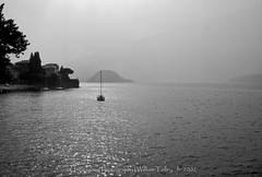 Lake Como in the Mist (uselessbay) Tags: 2002 canon canonf1 f1 ilfordpan100 italy lakecomo landscape uselessbaypphotography williamtalley blackandwhite film travel uselessbay water epsonperfectionv600