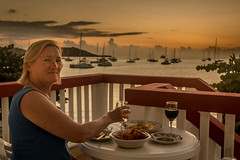 D15649E7 - Dinner At Sunset On St Martin (Bob f1.4) Tags: dinner terrace grand case st martin caribbean island woman sunset with boats harbor background water sail moorings anchored moored wine bread cheese