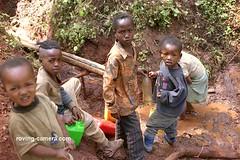 Children Gathering Water in southern Ethiopia, 2006 (deemixx) Tags: africa ethiopia drinkingwater safedrinkingwater ethiopianchildren watergathering gatheringwater childlabour childlabor