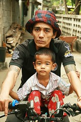father and son (the foreign photographer - ฝรั่งถ่) Tags: father son motorcycle nypd special operations plaid hat khlong thanon portraits bangkhen bangkok thailand canon kiss