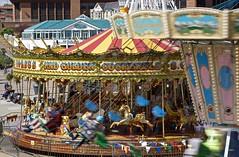 FunAtTheFair (Hodd1350) Tags: bournemouth dorset funfair carousel rides buildings roof colours zeissbatis zeisslens sony a7rll