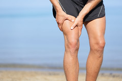 Muscle injury. Man with sprain thigh muscles (lydialim3) Tags: running injury muscle cramp pain leg runner accident adult athlete beach body cramps fit fitness injured injuries jogger jogging legs ligament male man men muscles muscular outdoors outside painful people person physical pull pulled pulling run rupture ruptures sore sport sports sprain strain stretching strong thigh thighs touching training workout