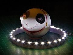 Macro Monday - Glaze - Maneki-neko in light ring (tomquah) Tags: macromondays glaze porcelain manekineko luckycat macro tomquah hmm canoneos5d flares lightsring led