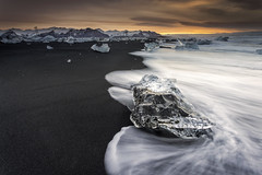 Sharpness (Perez Alonso Photography) Tags: ice iceberg iceland islandia sunset waves mar sea olas rocks stones black sand mountains landscapes jökulsárlón snow