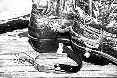 Heel Spurs (jah32) Tags: boots cowboyboots bw blackandwhite blackwhite cmwdbw monochromatic monochrome spurs tabletop stilllife western highkey