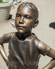 Fearless Girl Bronze Statue (2017) by Kristen Visbal, Financial District, New York City (jag9889) Tags: 2017 20170418 advertisement art artwork bowlinggreen broadway bronze chargingbull controversal fearless fearlessgirl financialdistrict genderdiversity girl indexfund kunst lowermanhattan manhattan ny nyc newyork newyorkcity outdoor people she sculpture skulptur statestreetglobaladvisors statue touristattraction usa unitedstates unitedstatesofamerica wallstreet women jag9889 us