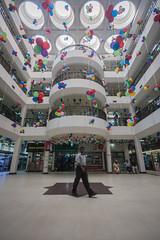 Getting out of the box !!! (zayembin.tajdid) Tags: dhaka bangladesh bangladeshi bazar complex computer idb 2017 man walk walking color colorful street photography photo line symmetry lining ballons