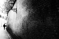 the wall (Sandy...J) Tags: atmosphere blackwhite monochrom street streetphotography walking wall black white man urban city nikon noir