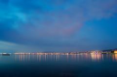 A city-seascape (stylian t) Tags: longexposure sea seascape clouds lights evening nikon cityscape bluesky greece le thessaloniki bluehour salonica 18mm purpleclouds d3200