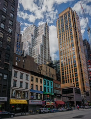 United colours of Manhattan (Мaistora) Tags: street city nyc windows sky urban usa distortion signs ny newyork color colour reflection building tower glass up vertical skyline architecture clouds skyscraper marriott buildings lens concrete us construction inn cityscape zoom crane manhattan steel painted sony profile restaurants wideangle growth planning jungle signage highrise shops nik kit colourful process residence skyward vignetting postprocess development pse edit topaz lightroom oss correction nex maistora 5r 1650mm yahoo:yourpictures=weather nex5r sel1650pz epz1650oss