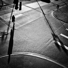 Just to walk a while in this light (. Jianwei .) Tags: street morning light shadow urban bw monochrome vancouver walking blackwhite mood stranger line curve pave nex kemily nex6