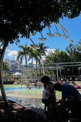 Here Comes the Water (Jocey K) Tags: sky people plants colour tree water architecture clouds buildings palms australia lagoon brisbane southbank queensland waterfountian southbankparklands streetsbeach boatpool