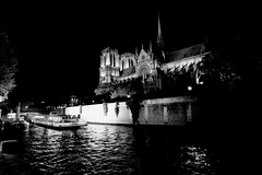 Notre-Dame Cathedral (oxfordblues84) Tags: blackandwhite bw paris france building water seine architecture night reflections river europe nightlights cathedral catholicchurch leftbank afterdark notredamecathedral gothicarchitecture frenchgothic îledelacité seineriver catholiccathedral 5photosaday fourtharrondissement roadscholar roadscholartour