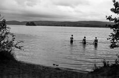 Evening Lake (Fabian Rah) Tags: travel camping people bw white lake black film nature water clouds analog 35mm canon 50mm photographie kodak sweden ae1 schweden roadtrip wanderlust sw scandinavia bw400cn