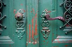 Door detail. Explored #160 (elinor04) Tags: door detail texture metal iron peeling paint decay budapest wroughtiron ironwork grating doorhandle terzvros