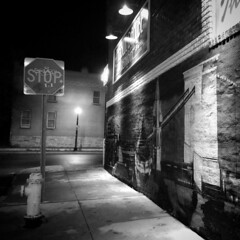 Side Street (tim.perdue) Tags: street old blue light columbus ohio bw white black west monochrome sign night corner dark square high empty side north sidewalk stop squareformat blake avenue deserted danube dube iphone iphoneography instagramapp uploaded:by=instagram foursquare:venue=4deae18f45dd3993a898db1a