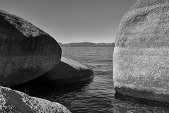 Tahoe Shores (rschnaible) Tags: california bw usa white mountain lake black mountains west water outdoors photography us high rocks nevada shoreline tahoe rocky monotone sierra boulders alpine shore western granite geology rugged geologic