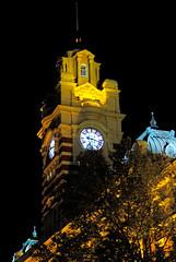 Melbourne Architecture In Spring - Flinders Station Clock Tower (#39 in series) 04Oct2014 (JAYKAY144) Tags: red white black tree brick yellow dark grey spring stripes cyan australia icon illuminated clocktower nightime trainstation nightlight copper iconic clockface mansard flindersstation melbournearchitecture