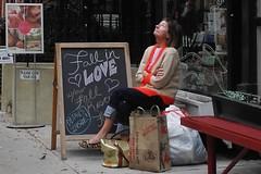 fall in love (omoo) Tags: newyorkcity woman westvillage streetscene neighbor greenwichvillage facials fallinlove skincare west11thstreet upwardlook dscn4344 justshopped rescueyourskin
