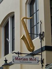 Saxophone Teacher Lives Here (mikecogh) Tags: sign promotion shop teacher saxophone wormerveer marjanmol