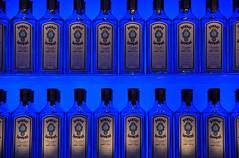 Blue Bottles (Anwen Gorry) Tags: blue light london geometric bombay gin sapphire vinopolis