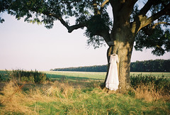 ot35 - wedding dress (johnnytakespictures) Tags: wedding sun white tree film nature sunshine gardens outfit lomo lomography afternoon dress natural farm olympus cotswolds farmland gloucestershire fields hanging analogue hang trip35 notgrove lomographycn100