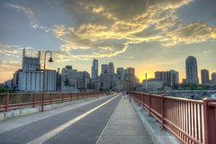 Stone Arch Sunset2 M3s (Greg Riekens) Tags: city bridge sunset minnesota skyline clouds nikon downtown minneapolis stonearch stonearchbridge d7000