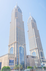 Twin towers in Dubai (MrSaha) Tags: twin towers dubai nikon d52000 dslr panaromic tall wide nature landscape manual earth top bright dim shadow light around view look travel happy life lively adventure globe world lonely peace peaceful calm quiet moment sharp clear soft beautiful capture red blue green color colors vivid vibrant legend shine day sun sunny sky street way road lamppost traffic signal path highway building architecture urban urbanite cityscape desert downtown landmark town busy